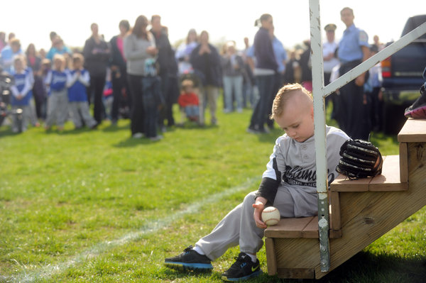 Four-year-old Collin Majka of Baltimore-Highlands plays with a ball during the opening ceremoy for Baltimore-Highlands, Lansdowne and Riverview Little League on Saturday, April 19. (Brian Krista/BSMG)