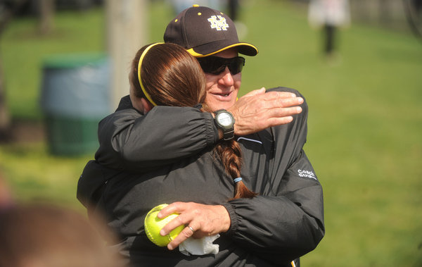 Mt. Hebron head coach Chuck Struhar is embraced by assistant coach Amy Guyton following their team's 7-3 win over Severna Park, which marked the 300th victory of Struhar's varsity softball career, during a softball tournament at Bachman Sports Complex on Saturday, April 19. Guyton has been a coach/player with Struhar for a good portion of his 300 wins. (Brian Krista/BSMG)