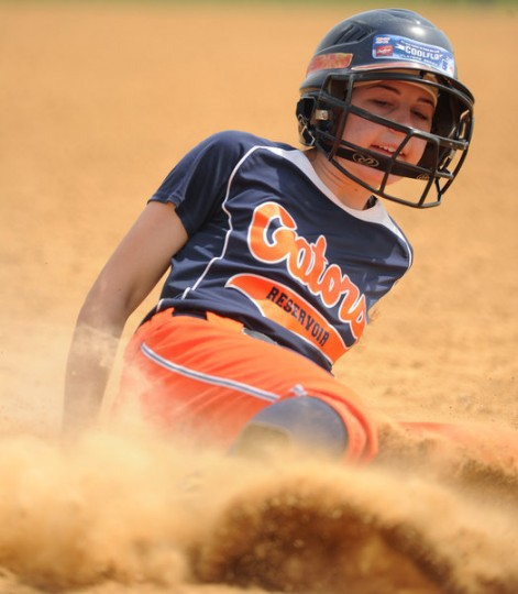 Reservoir's Robyn Pidliskey slides safely into home for a run during a softball tournament at Bachman Sports Complex on Saturday, April 19. (Brian Krista/BSMG)