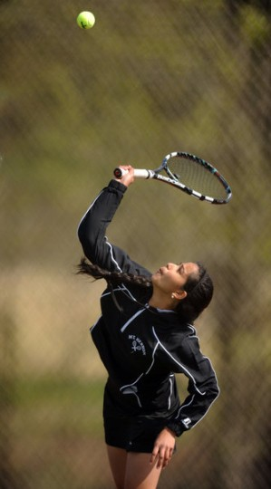 Mt. Hebron's Priya Emani serves in a singles match during a tennis match against Marriotts Ridge at Mt. Hebron High School on Wednesday, April 23.