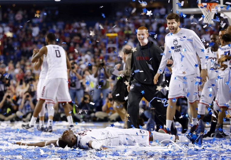 Connecticut Huskies center Amida Brimah (35) does confetti angles at center court as the Connecticut Huskies beat the Kentucky Wildcats 60-54 in the NCAA Final Four championship game at AT&T Stadium in Arlington, Texas, Monday, April 7, 2014. (Tom Fox/Dallas Morning News/MCT)