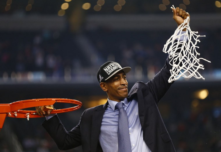 UConn head coach Kevin Ollie celebrates as he cuts down the net as the Connecticut Huskies beat the Kentucky Wildcats 60-54 in the NCAA Final Four championship game at AT&T Stadium in Arlington, Texas, Monday, April 7, 2014. (Ron Jenkins/Fort Worth Star-Telegram/MCT)