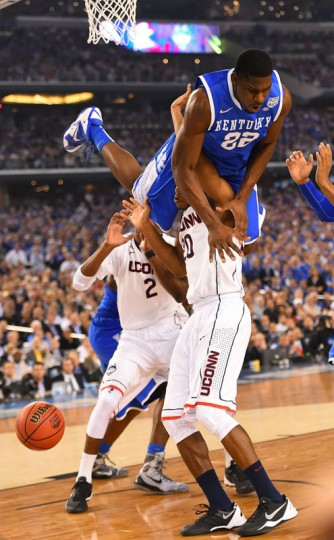 Alex Poythress (22) of Kentucky goes over Lasan Kromah (20) of Connecticut as the Connecticut Huskies beat the Kentucky Wildcats 60-54 in the NCAA Final Four championship game at AT&T Stadium in Arlington, Texas, Monday, April 7, 2014. (Harry E. Walker/MCT)
