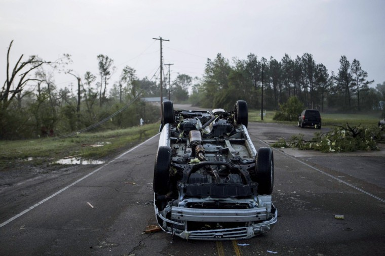A car rests on its roof along North Green Street on Tuesday morning, April 29, 2014, after a tornado passed through Tupelo, Miss. (Brad Vest/The Commercial Appeal)