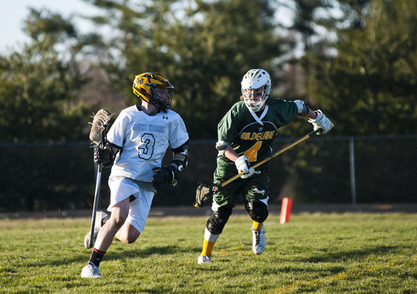 Wilde Lake's Luke Budorick defends against Mt. Hebron's Shane Brookhart during a boys lacrosse game on Monday, March 31. (Noah Scialom/BSMG)