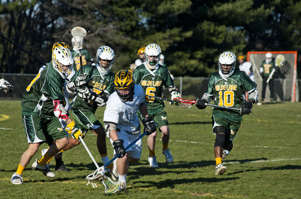 Mt. Hebron's Connor Dubois leads a pack of Wilde Lake players after the ball on Monday, March 31. (Noah Scialom/BSMG)