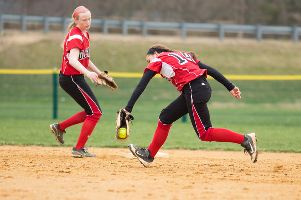 Glenelg's Sharon Mielke, right, makes the catch to take out a Howard batter as Glenelg's Everett Brittney, left, looks on during a game Friday, April 4. (Nate Pesce/BSMG)