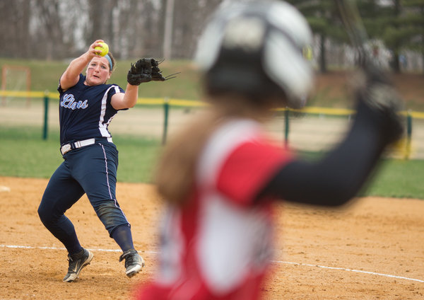 Howard's Kayli Paugh winds up a pitch for Glenelg's Sharon Mielke during a Howard County softball game on Friday, April 4. (Nate Pesce/BSMG)