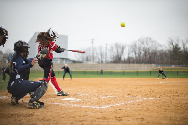 Glenelg's Morgan Perry connects with a pitch in a softball game against Howard Friday, April 4. (Nate Pesce/BSMG)