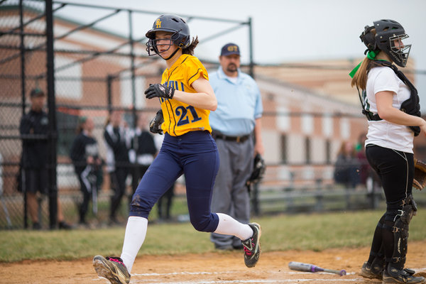 River Hill's Courtney Colosimo runs across home plate, putting up the first score of the game against Atholton Thursday, April 3. (Nate Pesce/BSMG)