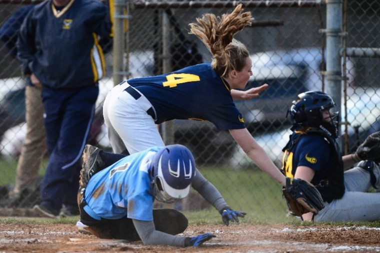 Elizabeth Anderson, top, of Catonsville collides with Sheena McKnight of Western Tech during a game April 9. (Matt Hazlett/BSMG)