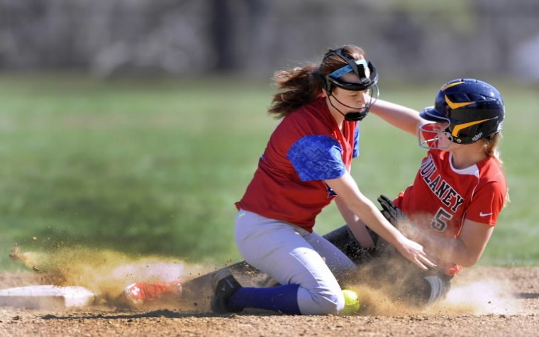 Dulaney baserunner Brooke Wall, right, slides safely into second base as Lansdowne shortstop Toni Turner covers in the first inning of a high school softball game Thursday, April 10 in Timonium. (Steve Ruark/BSMG))