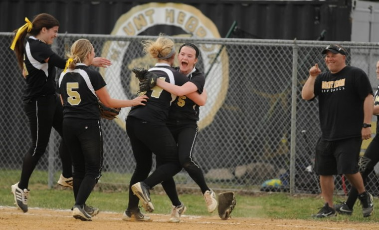 Mt. Hebron celebrate their one run victory over River Hill during a softball game at Mt. Hebron High School in Ellicott City on Friday, April 11. (Brian Krista/BSMG)