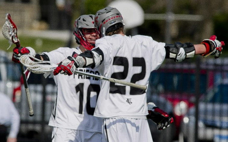 Friends School's William Mortimer, 10, and Edward Kasper, 22, celebrate an early goal during the boy's lacrosse matchup between Saints Peter and Paul High School and The Friends School April 11. (Scott Serio/BSMG)