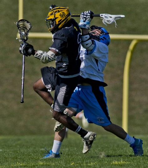 River Hill's Zach Beard crashes his stick into Mt. Hebron's Thomas Stone for a penalty during the Mt. Hebron versus River Hill boy's lacrosse game at River Hill High School in Clarksville, Maryland. (photo by Scott Serio / April 10, 2014)
