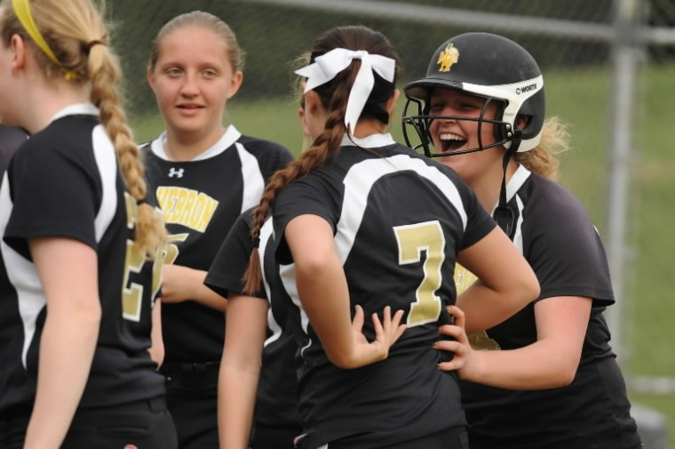 Alli Bluhm, right, celebrates with her Mt. Hebron teammates after her solo homerun gave them a one-run lead over River Hill during a softball game at Mt. Hebron High School in Ellicott City on Friday, April 11. (Brian Krista/BSMG)