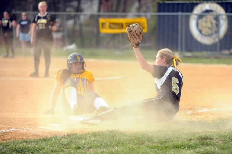 Mt. Hebron third baseman Stephanie Bluhm shows she has possession of the ball as she forces out River Hill baserunner Kinsey Johnson during a softball game at Mt. Hebron High School in Ellicott City on Friday, April 11. (Brian Krista/BSMG)