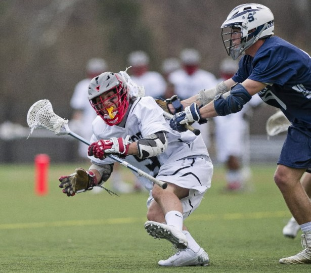 Bel Air's Austin Tredinnick, left, and Brad Casale celebrate a Casale goal that gave Bel Air a 1-0 lead against Fallston in the first half of a high school lacrosse game Friday, April 4, 2014 in Bel Air. (Photo by Steve Ruark