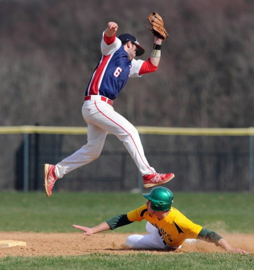 Bel Air infielder Nick Loiodice leaps to make the catch on the throw from home trying to tag North Harford's Brian Shaffer as he slides into second during April 8's game at North Harford. (Matt Button/BSMG)