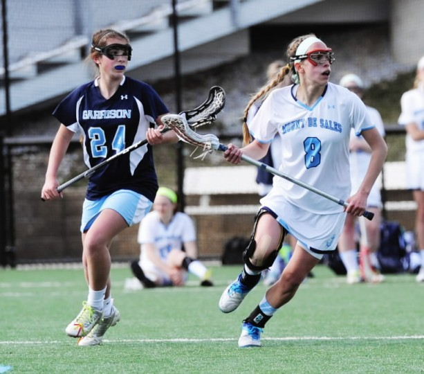 Mount de Sales' Allie Hynson, right, and Garrison Forest's Samantha Fiedler move toward the action during a game at Mount de Sales Academy in Catonsville on Wednesday, April 9. (Jon Sham/BSMG)