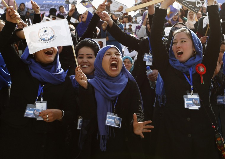 Supporters of Afghan presidential candidate Ashraf Ghani cheer during an election campaign in Kabul April 1, 2014. The Afghan presidential elections will be held on April 5. (Mohammad Ismail/Reuters)