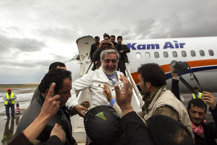 Afghan presidential candidate Abdullah Abdullah shakes hands with supporters as he arrives to attend an election campaign in Herat province April 1, 2014. The Afghan presidential elections will be held on April 5. (Zohra Bensemra/Reuters)
