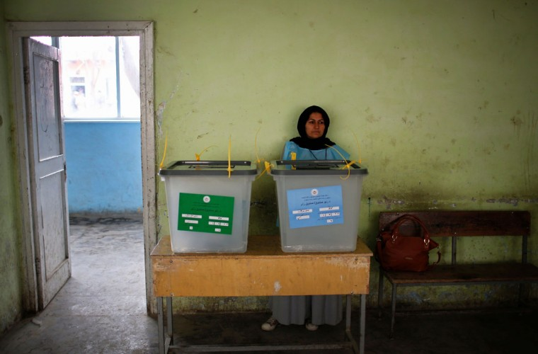An Afghan electoral official waits for voters at a polling station in Kabul April 5, 2014. Voting began on Saturday in Afghanistan's presidential election, which will mark the first democratic transfer of power since the country was tipped into chaos by the fall of the hardline Islamist Taliban regime in 2001. (REUTERS/Ahmad Masood)