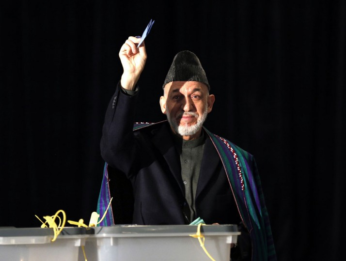 Afghan President Hamid Karzai casts his vote in Kabul April 5, 2014. Voting began on Saturday in Afghanistan's presidential election, which will mark the first democratic transfer of power since the country was tipped into chaos by the fall of the hardline Islamist Taliban regime in 2001. (REUTERS/Mohammad Ismail)