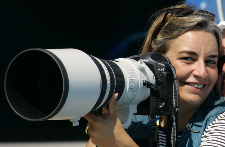 AP photographer Anja Niedringhaus laughs as she attends a swimming event at the 2004 Olympic Games in Athens, August 21, 2004. Niedringhaus, a veteran Associated Press photographer who had covered wars around the world was shot dead and another reporter was wounded on April 4, 2014 when an Afghan policeman opened fire on them in eastern Afghanistan, the news agency said. Picture taken August 21, 2004. || PHOTO CREDIT: STAFF - REUTERS