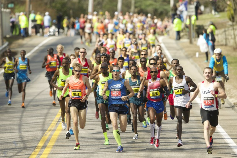 Elite runners, including Ryan Hall and Meb Keflezighi, race during the 2014 Boston Marathon. (David Butler II-USA TODAY Sports)