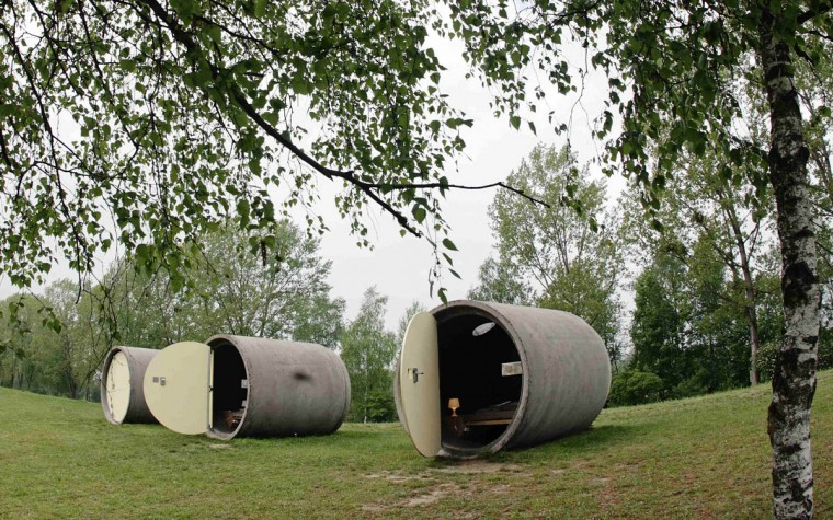 """Dasparkhotel"" hotel rooms are pictured in a public park in the Upper Austrian town of Ottensheim. The rooms are constructed from repurposed concrete drain pipes and can be booked anonymously on the internet. Owner Andreas Strauss says the hotel is a hospitality project on a ""pay as you wish"" basis, a system where customers pay what they can afford. The hotel is open from May 1 till October 1. (Heinz-Peter Bader/Reuters photo)"