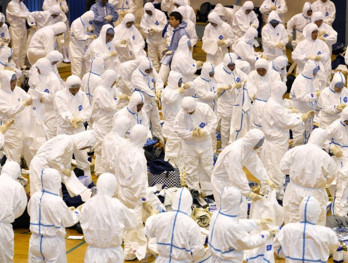 Prefectural government employees and other workers put on protective suits to cull chickens in Taragi town, Kumamoto prefecture, in this photo taken by Kyodo. Two chickens have tested positive for avian influenza at a farm in Japan where more than 1,000 chickens have died, marking the country's first case of bird flu in three years, the Agricultural Ministry said on Sunday. The highly pathogenic H5 virus was detected through genetic testing of chickens at a farm in Kumamoto prefecture in the south, the ministry said on its website. Mandatory credit (Kyodo/Reuters)