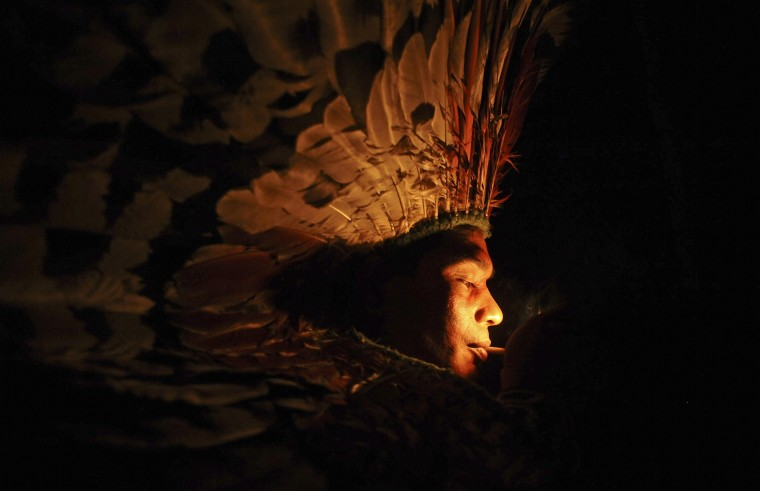 A Huni Kui Indian smokes herbs during a ritual in the village of Novo Segredo along the Envira river of Brazil's northwestern Acre state, March 8, 2014. Many indigenous groups, including the Huni Kui, Ashaninka, and Madija, live in villages in the Brazilian rainforest near the border with Peru. (REUTERS/Lunae Parracho)