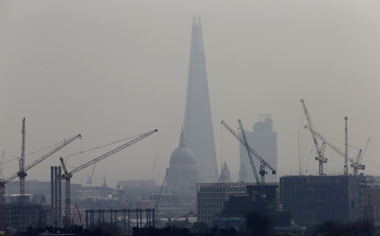 Smog surrounds The Shard, western Europe's tallest building, and St Paul's Cathedral in London April 3, 2014. A dust cloud from the Sahara has covered south east England, raising pollution levels to the highest level in London, preventing people taking exercise outdoors, including the Prime Minister, David Cameron, who said he had skipped his morning jog. (REUTERS/Suzanne Plunkett)