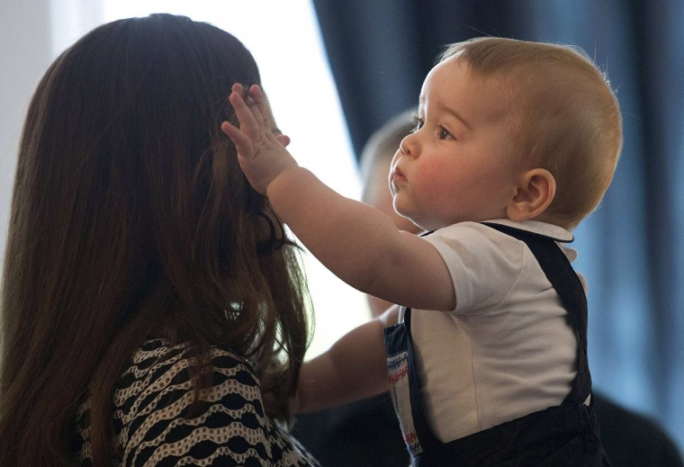 Catherine, Duchess of Cambridge, holds her son Prince George during a Plunket nurse and parents' group event at Government House in Wellington. Plunket is a national not-for-profit organization that provides care for children and families in New Zealand. Britain's Prince William and his wife Kate are undertaking a 19-day official visit to New Zealand and Australia with their son George. (Marty Melville/Pool/Reuters)