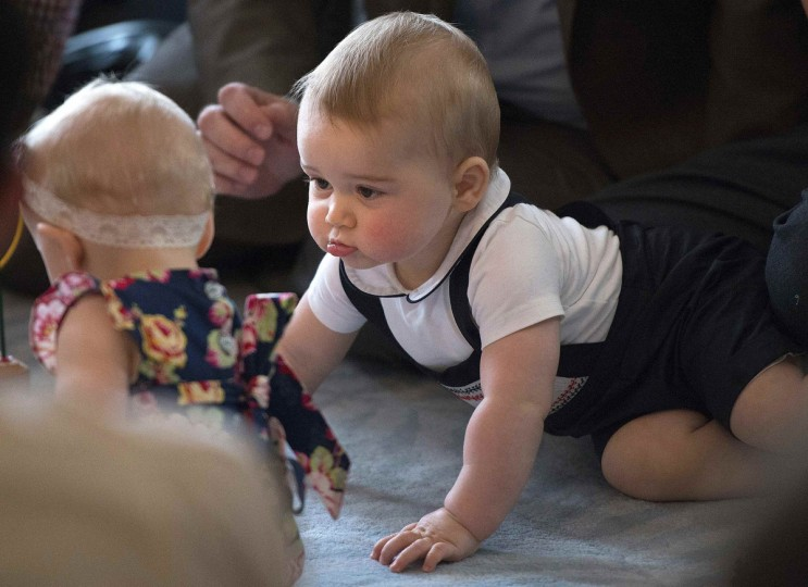 Prince George, son of Britain's Prince William and his wife Catherine, the Duchess of Cambridge, looks at other babies during a Plunket nurse and parents group event at the Government House in Wellington. Royal New Zealand Plunket Society, or Plunket for short, is a national not-for-profit organization that provides care for children and families in New Zealand. Britain's Prince William and his wife Kate are undertaking a 19-day official visit to New Zealand and Australia with their son George. (Marty Melville/Pool/Reuters)