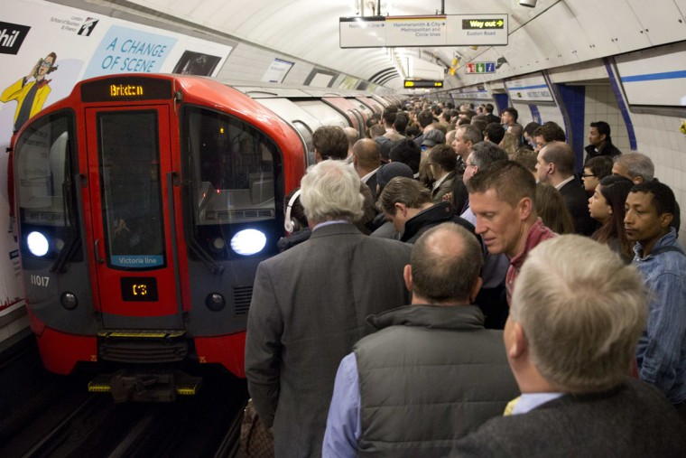 Commuters board an underground train at King's Cross station in London April 29, 2014. Millions of commuters faced transport chaos on Tuesday after eleventh-hour talks failed to avert a two-day strike on the London Underground train network over plans to cut jobs and close ticket offices. (Neil Hall/Reuters)