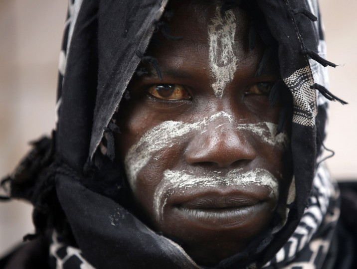 A member of the anti-balaka, a Christian militia, looks on in the village of Zawa April 8, 2014. (REUTERS/Goran Tomasevic)