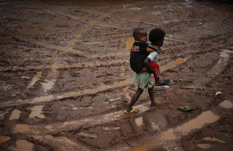 Children walk during rain in front of Saint Michel Catholic church in the town of Boda April 14, 2014. (Goran Tomasevic/Reuters)