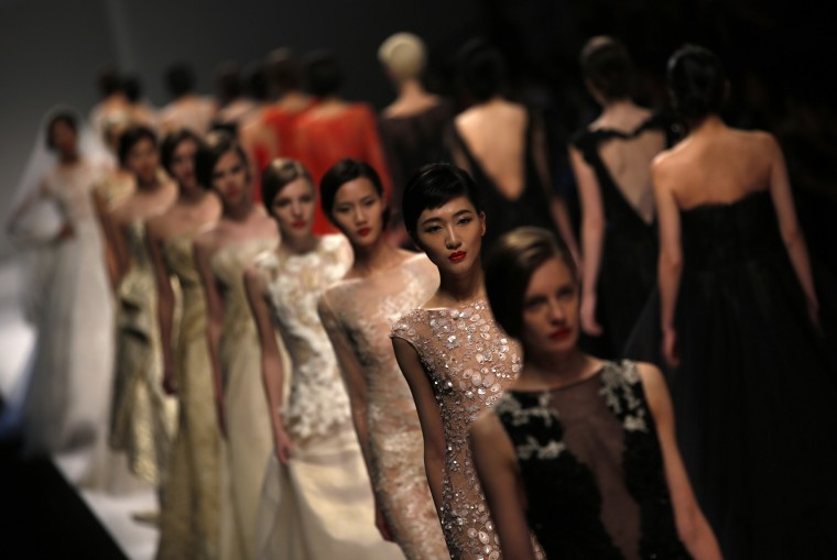 Models presents creations by We Couture during Shanghai Fashion Week April 11, 2014.  || PHOTO CREDIT: CARLOS BARRIA   - REUTERS