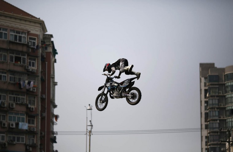 A competitor performs in the FMX Course competition during the World Extreme Games in Shanghai. The games will be held in Shanghai until May 3. (Carlos Barria/Reuters photo)