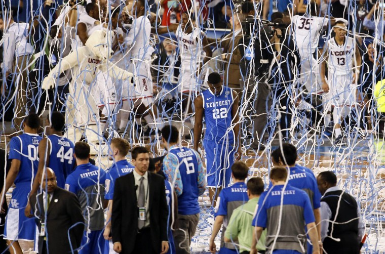Kentucky Wildcats forward Alex Poythress (22) walks off the court as the Connecticut Huskies winning the championship game of the Final Four in the 2014 NCAA Mens Division I Championship tournament at AT&T Stadium. (Kevin Jairaj-USA TODAY Sports)