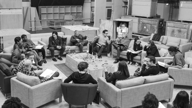 "Writer/Director/Producer J.J. Abrams (top center in glasses) conducts a cast reading for ""Star Wars: Episode VII"" at Pinewood Studios in Buckinghamshire in this publicity photo taken and released to Reuters April 29, 2014. Clockwise from Abrams are Harrison Ford, Daisy Ridley, Carrie Fisher, Peter Mayhew, Producer Bryan Burk, Lucasfilm President and Producer Kathleen Kennedy, Domhnall Gleeson, Anthony Daniels, Mark Hamill, Andy Serkis, Oscar Isaac, John Boyega, Adam Driver and writer Lawrence Kasdan. (David James/Copyright (c) Lucasfilm Ltd. & TM. All Rights Reserved/The Walt Disney Company/Reuters Handout)"