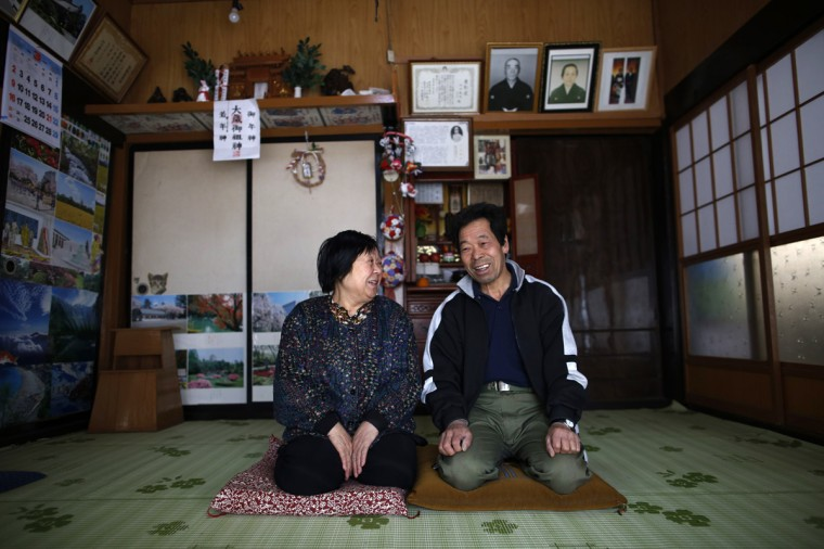 Toshio Koyama, 72, and his wife Kimiko, 69, who evacuated from the Miyakoji area of Tamura three years ago, smile after they returned to their home in Tamura, Fukushima prefecture April 1, 2014. For the first time since Japan's Fukushima nuclear disaster more than three years ago, residents of the small district 20 km (12 miles) from the wrecked plant are allowed to return home. The Miyakoji area, a northeastern city inland from the Fukushima nuclear station, has been off-limits for most residents since March 2011, when the government ordered evacuations after a devastating earthquake and tsunami triggered triple meltdowns at the power station. (Issei Kato/Reuters)