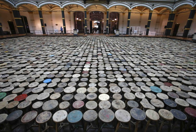 """A general view of the installation """"Stools"""" by Chinese artist Ai Weiwei pictured during a media preview of the 'Evidence' exhibition at the Martin-Gropius Bau in Berlin. The exhibition opens from from April 3 to July 7 in the German capital. (Fabrizio Bensch/Reuters)"""