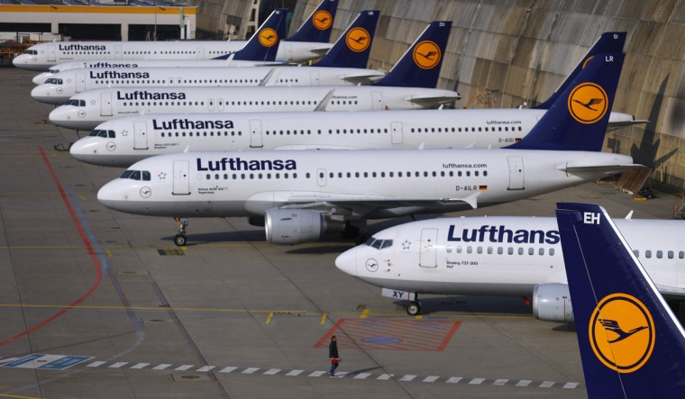 Aircraft of German airline Lufthansa are parked on the apron during a strike at Fraport airport in Frankfurt . Lufthansa pilots started a three-day walkout on Wednesday, effectively grounding Germany's largest airline in one of the biggest strikes ever to hit the company. Lufthansa has cancelled 3,800 flights during the strike, which runs until the end of Friday, and says the strike will cost it tens of millions of euros. The pilots are striking to demand that Lufthansa reinstate an early retirement scheme . (Kai Pfaffenbach/Reuters)