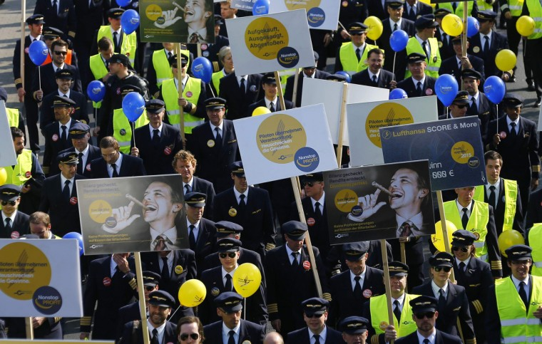 Pilots of German airline Lufthansa take part in a demonstration during strike action at Fraport airport in Frankfurt. Lufthansa pilots started a three-day walkout on Wednesday, effectively grounding Germany's largest airline in one of the biggest strikes ever to hit the company. Lufthansa has cancelled 3,800 flights during the strike, which runs until the end of Friday, and says the strike will cost it tens of millions of euros. The pilots are striking to demand that Lufthansa reinstate an early retirement scheme . (Kai Pfaffenbach/Reuters)