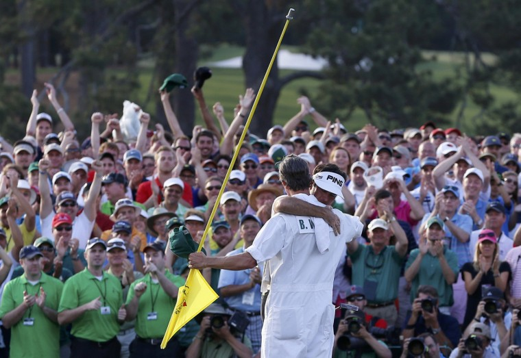 U.S. golfer Bubba Watson (rear) hugs caddie Ted Scott after winning the Masters golf tournament at the Augusta National Golf Club in Augusta, Georgia. (Jim Young/Reuters)