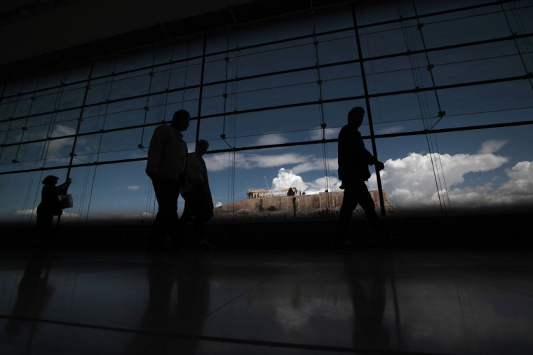 Tourists visit the Acropolis museum as the temple of the Parthenon is seen in the background in Athens April 25, 2014. (REUTERS/Alkis Konstantinidis)