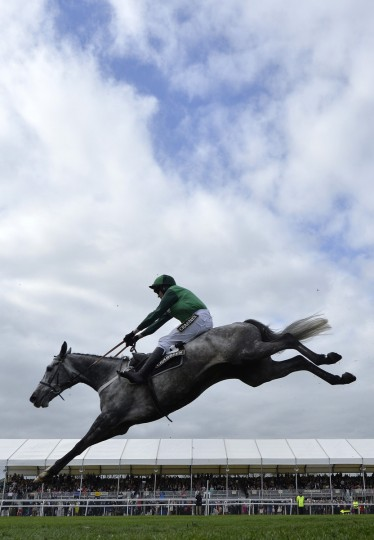 Ma Filleule ridden by Barry Geraghty clears the final fence on the way to winning the 'Supporting The Everton In The Community Steeple Chase' during the Grand National horse racing meeting at Aintree, northern England April 4, 2014. (Toby Melville/Reuters photo)